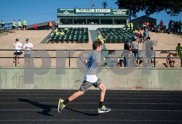 Ethan Janecek, 13, runs in the 30th annual St. Gregory Fun Run held at the Bishop Thomas K. Gorman campus in Tyler Saturday Sept.  19, 2015. The event is a fundraiser for St. Gregory Cathedral School, Tyler's oldest private, Christian elementary school.  (Sarah A. Miller/Tyler Morning Telegraph)