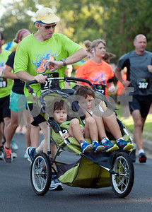 To Bochow of Tyler pushes his sons Andrew Bochow, 5, and Samuel Bochow, 6, in a stroller during the 30th annual St. Gregory Fun Run held at the Bishop Thomas K. Gorman campus in Tyler Saturday Sept.  19, 2015. The event is a fundraiser for St. Gregory Cathedral School, Tyler's oldest private, Christian elementary school.  (Sarah A. Miller/Tyler Morning Telegraph)