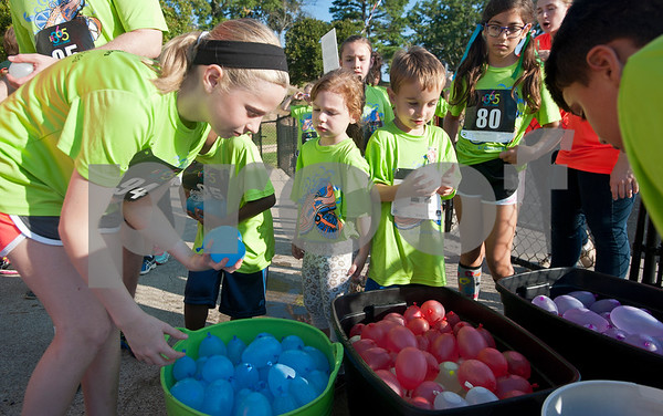 Kids purchase water balloons to throw at runners near the finish line during the 30th annual St. Gregory Fun Run held at the Bishop Thomas K. Gorman campus in Tyler Saturday Sept.  19, 2015. The event is a fundraiser for St. Gregory Cathedral School, Tyler's oldest private, Christian elementary school.  (Sarah A. Miller/Tyler Morning Telegraph)