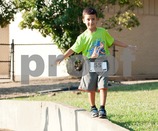Luca Guzzetta, 5, walks around McAllum Stadium during the 30th annual St. Gregory Fun Run held at the Bishop Thomas K. Gorman campus in Tyler Saturday Sept.  19, 2015. The event is a fundraiser for St. Gregory Cathedral School, Tyler's oldest private, Christian elementary school.  (Sarah A. Miller/Tyler Morning Telegraph)