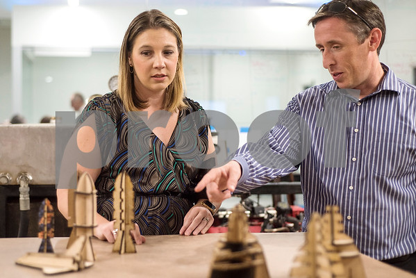 Kristen and Brad O'Leary look at models made by students during a reception in the Center for Innovation at All Saints Episcopal School in Tyler, Texas, on Tuesday, Sept. 26, 2017. The new space at the school allows students the opportunity for on-hands learning with some of the latest technology. (Chelsea Purgahn/Tyler Morning Telegraph)