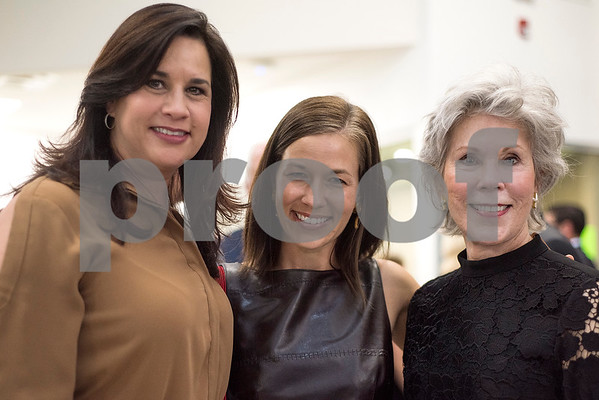 Misty Francis, Gretchen Mercer and DeeDee Bufe pose for a photo during a reception in the Center for Innovation at All Saints Episcopal School in Tyler, Texas, on Tuesday, Sept. 26, 2017. (Chelsea Purgahn/Tyler Morning Telegraph)