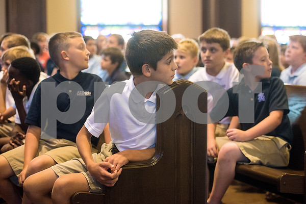 Students look back towards Mark Kelly, not pictured, as he is introduced at All Saints Episcopal School in Tyler, Texas, on Tuesday, Sept. 26, 2017. Kelly, a retired American astronaut, engineer and Navy combat veteran, spoke to the students about his career and answered questions. (Chelsea Purgahn/Tyler Morning Telegraph)