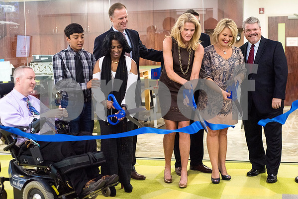 Donors cut a ribbon during a reception in the Center for Innovation at All Saints Episcopal School in Tyler, Texas, on Tuesday, Sept. 26, 2017. The new space at the school allows students the opportunity for on-hands learning with some of the latest technology. (Chelsea Purgahn/Tyler Morning Telegraph)