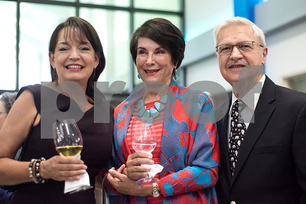Donna Fraser, Patricia Hampe and Dr. Clark Hampe Sr. pose for a photo during a reception in the Center for Innovation at All Saints Episcopal School in Tyler, Texas, on Tuesday, Sept. 26, 2017. (Chelsea Purgahn/Tyler Morning Telegraph)