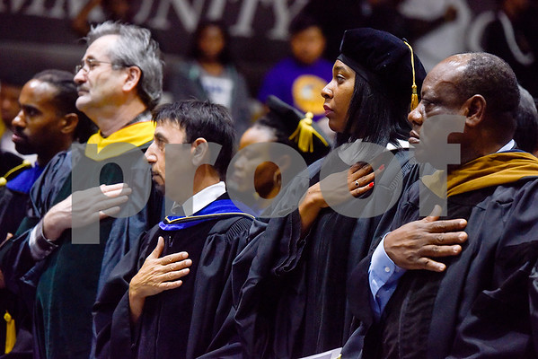 Faculty listen to the national anthem played by the Texas College Band during the Opening School Convocation at Texas College in Tyler, Texas, on Tuesday, Sept. 26, 2017. The event featured a number of speakers and musical performances to welcome the new freshmen to the school. (Chelsea Purgahn/Tyler Morning Telegraph)