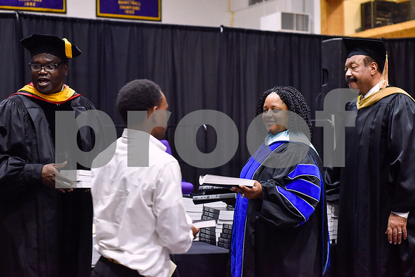 Faculty hand out bibles to students as a gift during the Opening School Convocation at Texas College in Tyler, Texas, on Tuesday, Sept. 26, 2017. The event featured a number of speakers and musical performances to welcome the new freshmen to the school. (Chelsea Purgahn/Tyler Morning Telegraph)