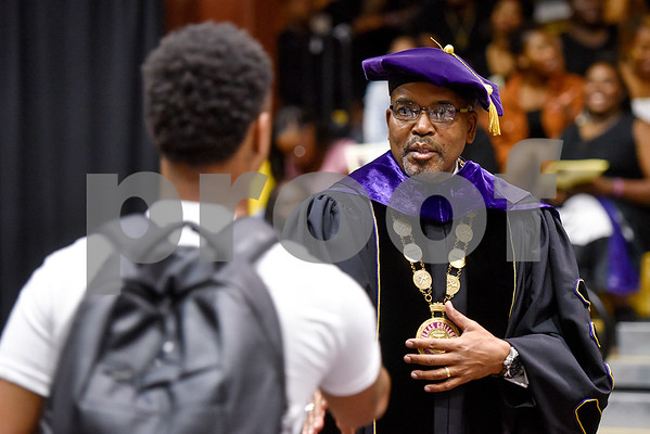 Dr. Dwight J. Fennell, President of Texas College, shakes hands with a student during the Opening School Convocation at Texas College in Tyler, Texas, on Tuesday, Sept. 26, 2017. The event featured a number of speakers and musical performances to welcome the new freshmen to the school. (Chelsea Purgahn/Tyler Morning Telegraph)