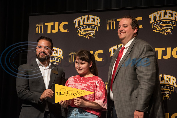 Winona High School freshman Marisa Ventura, 14, has her photo taken with TJC Promise Director Matthew Ramirez, left, and Winona ISD Superintendent Cody Mize, right, at the signing ceremony for the TJC Promise at their school on Sept. 30, 2019.  (Sarah A. Miller/Tyler Morning Telegraph)