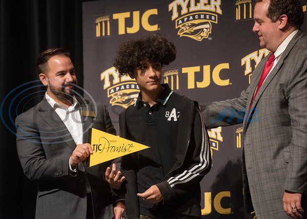 TJC Promise Director Matthew Ramirez, left, and Winona ISD Superintendent Cody Mize, right, take photos with freshman students at the signing ceremony for the TJC Promise at Winona High School on Sept. 30, 2019.  (Sarah A. Miller/Tyler Morning Telegraph)