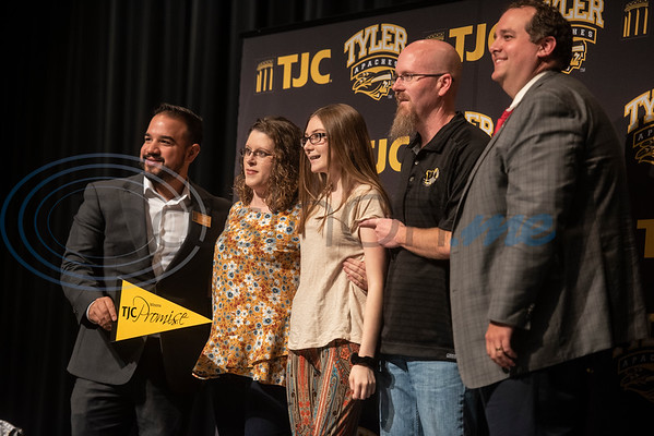 Winona High School freshman Bailee Wilson, 14, has her photo taken with her parents as well as TJC Promise Director Matthew Ramirez, left, and Winona ISD Superintendent Cody Mize, right, at the TJC Promise signing ceremony at the school on Sept. 30, 2019.  (Sarah A. Miller/Tyler Morning Telegraph)