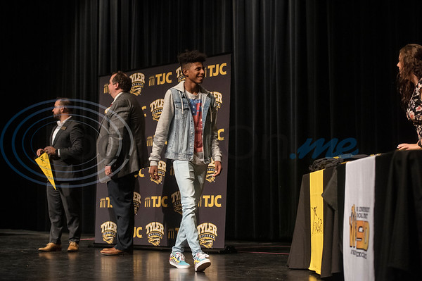 Winona High School freshman Nate Hampton, 14, walks across the stage at TJC Promise signing ceremony at the school on Sept. 30, 2019.  (Sarah A. Miller/Tyler Morning Telegraph)
