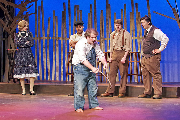 "Mark Maynard | for The Herald Bulletin<br /> Luella Bennett (Skyla Bruno), Melvin Wilder (Noah Robinson), Dewey Maples (Mac White) and Basil Bennet (Jack Render) look on as Buddy Layman (Isaac Derkach) uses a devining stick to search for water in Anderson University's presentation of ""The Diviners."""