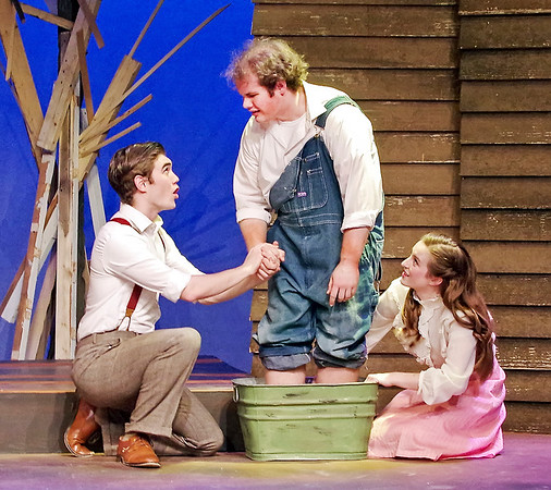 Mark Maynard   for The Herald Bulletin<br /> C. C. Showers (Samuel Lynch) and Jennie Mae Layman (Juli Biagi) successfully coax her brother, Buddy (Isaac Derkach) who is deathly afraid of water, to finally bathe his severly itching feet.