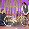 Mark Maynard | for The Herald Bulletin<br /> While Ferris Layman (Conner Thompson) checks out the rear tire, Basil Bennett (Jack Render) inflates the front one on his Schwinn bicycle.