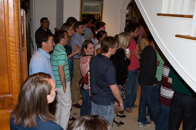 Recent graduates (new alums) found themselves under the staircase, observing the introductions.