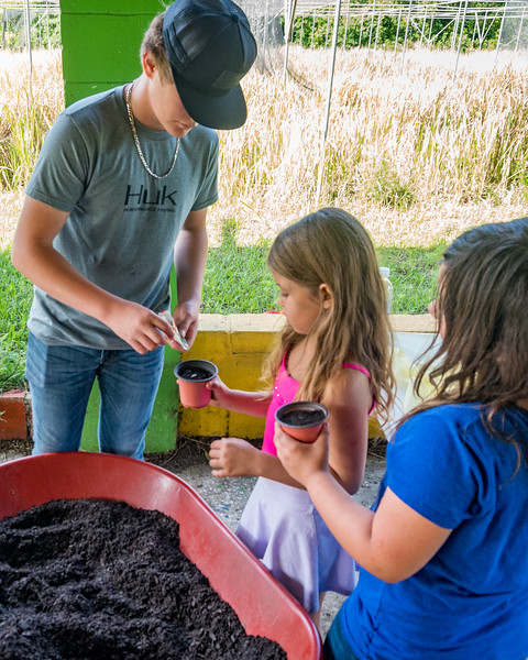 Joseph A. Long Elementary students got to plant a bean seed to take home with them at the ag day FFA students at Jenkins Middle School put on for them on Monday. Fran Ruchalski/Palatka Daily News