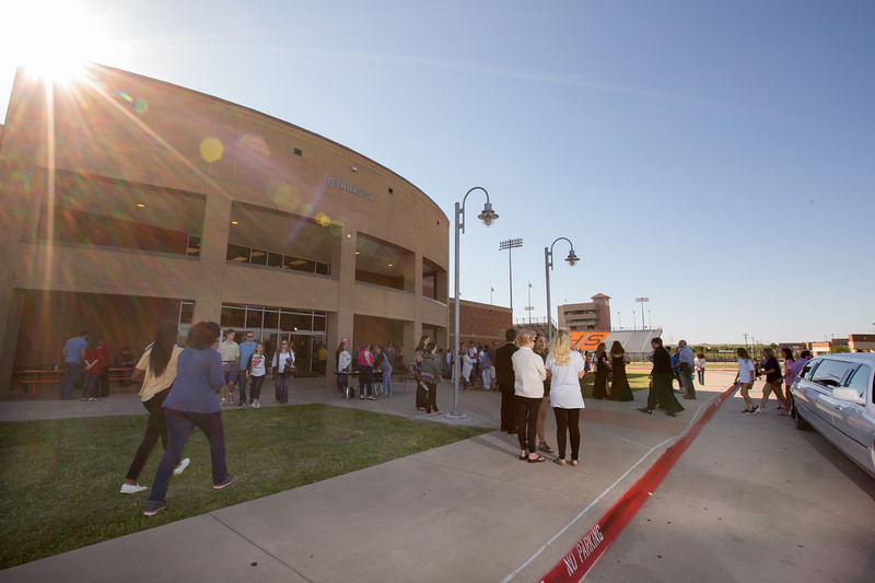 Prom students, parents and guests arrive at the Aledo High School gymnasium for Promenade.
