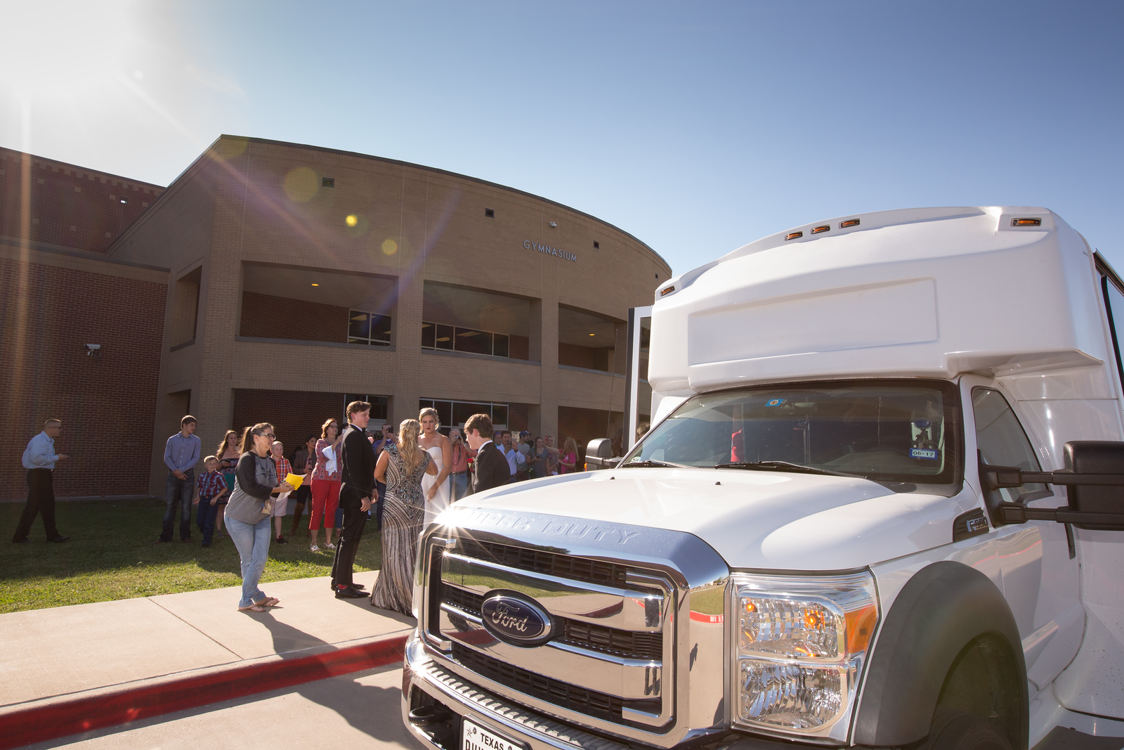 Parent volunteer Tracy Griffin checks in a van filled with prom guests before Promenade.