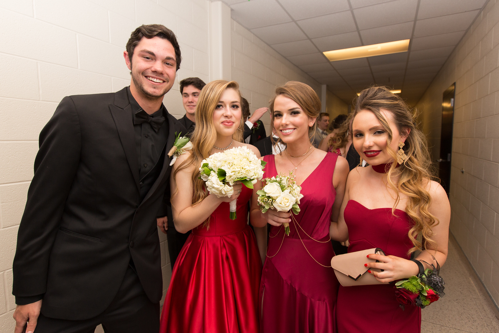 Noah Hill, Ellie Posey, Shelby Cooper, and Amanda Paulsen wait in line for Promenade.