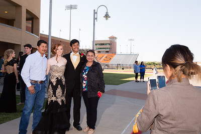 Diana de la Cerda takes cell phone pictures of Jose Armando de la Cerda, Ally Collinsworth, Daniel de la Cerda, and Esperanza de la Cerda before Promenade.