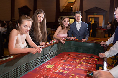 Emily Rappaport (3rd from left) tosses dice at the craps table with Katy Forsythe, Emma Lleverino, and Caden Primera.