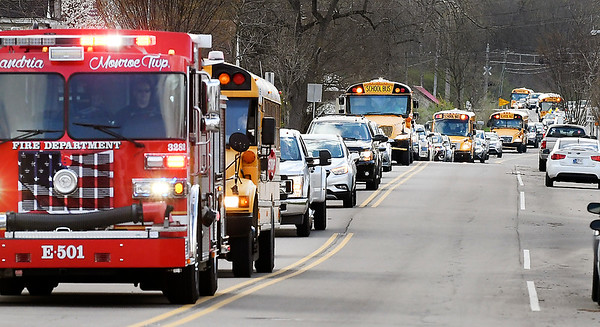 Alexandria Community Schools teachers and staff parade through town Monday for their students.