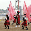 Don Knight | The Herald Bulletin<br /> Danny Boy, portrayed by Coby Richardson, is circled by the color guard during the Marching Highlanders' performace at the State Fair Band Day competition on Saturday.