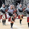 Don Knight | The Herald Bulletin<br /> Anderson's bag pipers walk onto the track during Indiana State Fair Band Day on Saturday.