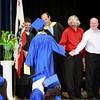 Superintendent Amelio and Principal Livingstone congratulate Andrew.
