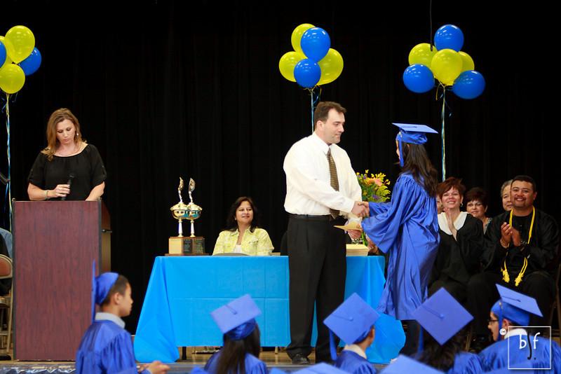 Hoang Nguyen receives her diploma.