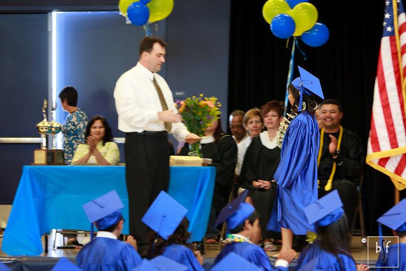 Mr. Hamby gives Jayann her diploma.