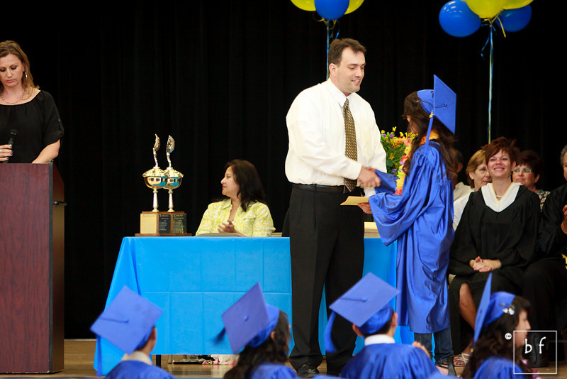 My Vien receives her diploma.