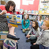 Fitchburg State University Professor Jannette McMenamy reads to children during Applewild School's Community Reading Day on Wednesday morning. SENTINEL & ENTERPRISE / Ashley Green