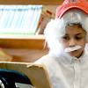 Second graders at Applewild School in Fitchburg performed a living wax museum in the schools library on Thursday morning. They each picked a famous person and played them as wax figures as students from the school paraded through. They got to see what each famous person looked like and read about them on tri-folds of research the students did. Playing Albert Einstein is Second Grader Ethan Shetti. SENTINEL & ENTERPRISE/ JOHN LOVE