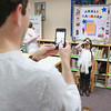 Second graders at Applewild School in Fitchburg performed a living wax museum in the schools library on Thursday morning. They each picked a famous person and played them as wax figures as students from the school paraded through. They got to see what each famous person looked like and read about them on tri-folds of research the students did. Desh Hindle takes a picture of his daughter second grader Serena Hindle as she plays Amelia Earhart during the living wax museum. SENTINEL & ENTERPRISE/ JOHN LOVE