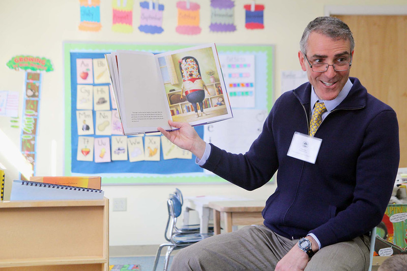 ken Ansin with Enterprise Bank reads to Bailey Shea's Kindergarten class at the Applewild school in Fitchburg on Wednesday during community reading day. SENTINEL & ENTERPRISE/JOHN LOVE