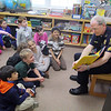 Fitchburg Police Sgt. Glenn Fossa reads to Kathie Grzewinski second grade class at the Applewild school in Fitchburg on Wednesday during community reading day. SENTINEL & ENTERPRISE/JOHN LOVE