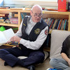 Fitchburg Deputy Fire Chief Kevin Curran reads to Kevin Broder's fifth grade class at the Applewild school in Fitchburg on Wednesday during community reading day. SENTINEL & ENTERPRISE/JOHN LOVE