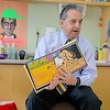 Fitchburg State University President Robert Antonucci reads to Mike Mullins fifth grade class at the Applewild school in Fitchburg on Wednesday during community reading day. SENTINEL & ENTERPRISE/JOHN LOVE