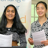 "Applewild School eighth graders Neha Agarwal, 14, and Daphne Wong, 14, give a presentation on their ""Little Blue Book Shop"" to the United Way Youth Venture group on Tuesday at the school. SENTINEL & ENTERPRISE/JOHN LOVE"