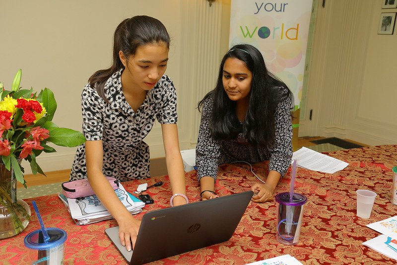 Applewild School eighth graders Daphne Wong, 14, and Neha Agarwal, 14, set up for their United Way Youth Venture presentation on Tuesday at the school. SENTINEL & ENTERPRISE/JOHN LOVE