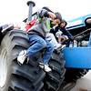 "Cody Xiong of Aspen Creek K-8 School in Broomfield, jumps off a giant Ford Tractor during the farm equipment tour.<br /> Fourth graders from Boulder Valley Schools were able to learn about farms and food at the Arapahoe Campus Farm Day on thursday. For a video and more photos, go to  <a href=""http://www.dailycamera.com"">http://www.dailycamera.com</a>.<br /> Cliff Grassmick  / October 4, 2012"