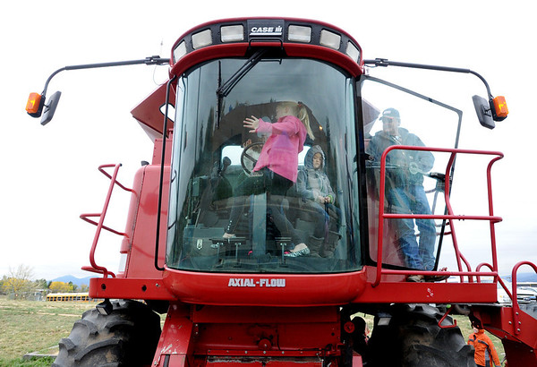 "Fourth-graders, Jameson Amon, Ashlyn McGregor and Koryn McCarthy, play inside the cab of a wheat cutter during the farm tour.<br /> Fourth graders from Boulder Valley Schools were able to learn about farms and food at the Arapahoe Campus Farm Day on thursday. For a video and more photos, go to  <a href=""http://www.dailycamera.com"">http://www.dailycamera.com</a>.<br /> Cliff Grassmick  / October 4, 2012"