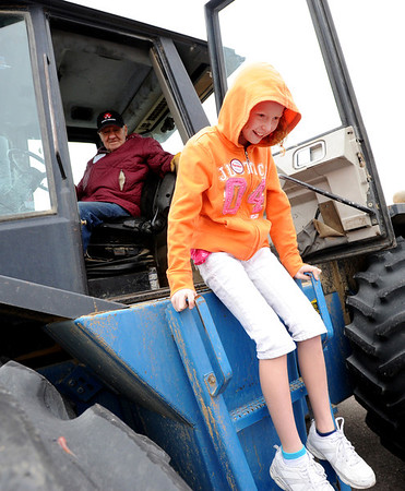 """Alexa Fidler gets off the tractor after an explanation by farmer Bob Clyncke.<br /> Fourth graders from Boulder Valley Schools were able to learn about farms and food at the Arapahoe Campus Farm Day on thursday. For a video and more photos, go to  <a href=""""http://www.dailycamera.com"""">http://www.dailycamera.com</a>.<br /> Cliff Grassmick  / October 4, 2012"""