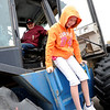 "Alexa Fidler gets off the tractor after an explanation by farmer Bob Clyncke.<br /> Fourth graders from Boulder Valley Schools were able to learn about farms and food at the Arapahoe Campus Farm Day on thursday. For a video and more photos, go to  <a href=""http://www.dailycamera.com"">http://www.dailycamera.com</a>.<br /> Cliff Grassmick  / October 4, 2012"