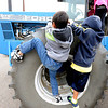 "Cody Xiong, left, and Chase Kennedy, both of Aspen Creek K-8 School in Broomfield, climb the tire of a giant Ford Tractor during the farm equipment tour.<br /> Fourth graders from Boulder Valley Schools were able to learn about farms and food at the Arapahoe Campus Farm Day on thursday. For a video and more photos, go to  <a href=""http://www.dailycamera.com"">http://www.dailycamera.com</a>.<br /> Cliff Grassmick  / October 4, 2012"