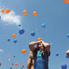 Silver Creek Primary School kindergarten students Trinity Weatherbee. left, Emma Schoenbachler, center, and Addison Snyder watch as more than 200 balloons were released by kindergarten students Tuesday afternoon to celebrate the first day of school. Each balloon has the students name, school's address and a request to respond if you find the balloon. Staff photo by C.E. Branham