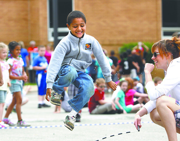 Kindergarten student Jeremiah Amig enjoys jumping a rope during field day at Clarksville Elementary School on Friday. Staff photo by C.E. Branham