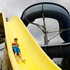 Parkwood Elementary School fifth-grader Dylan Fawbush goes down a water slide at the Jeffersonville Aquatic Center on Thursday morning. Fawbush and the rest of the student body from the school were rewarded with a day at the center for clocking the most steps, using pedometers, in the Greater Clark County Schools Fitness Challenge. This is the third year in a row that Parkwood has placed first in the challenge, although this year they tied with Bridgepoint Elementary School. Staff photo by Christopher Fryer